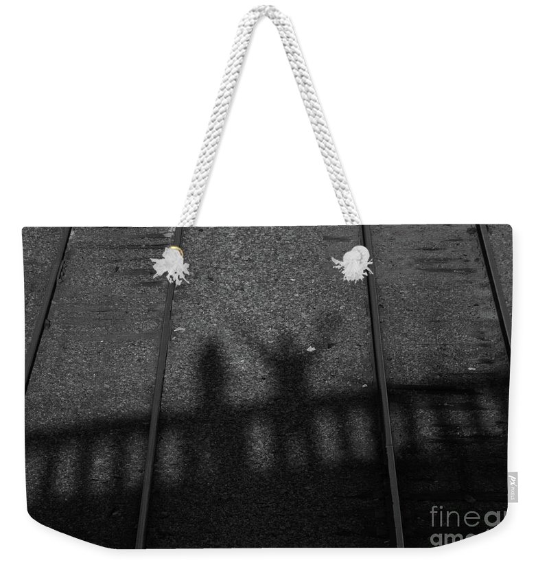 Shadow Weekender Tote Bag featuring the photograph Beware Of The Shadows Black And White by Karol Livote