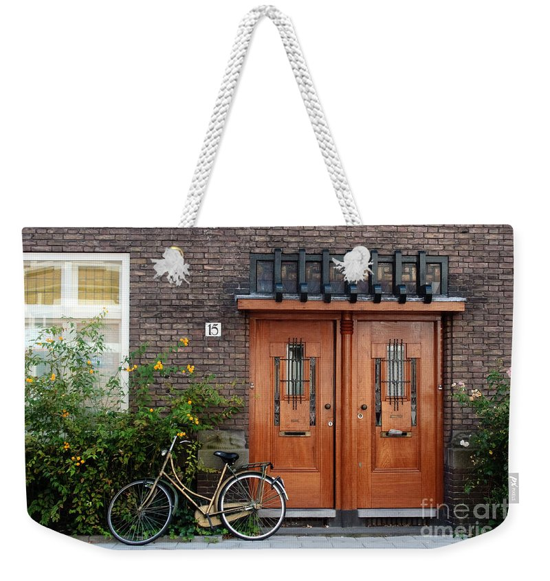 Bicycle Weekender Tote Bag featuring the photograph Bicycle And Wooden Door by Thomas Marchessault