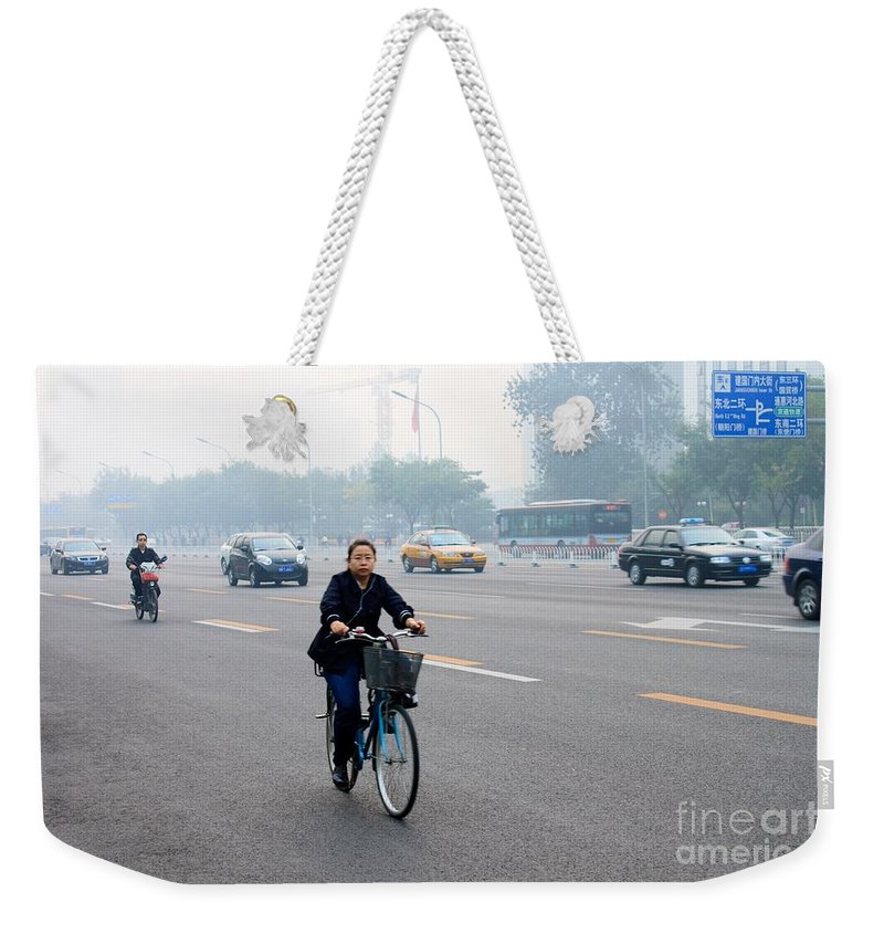 Bicycle Weekender Tote Bag featuring the photograph Bicyclist In Beijing by Thomas Marchessault