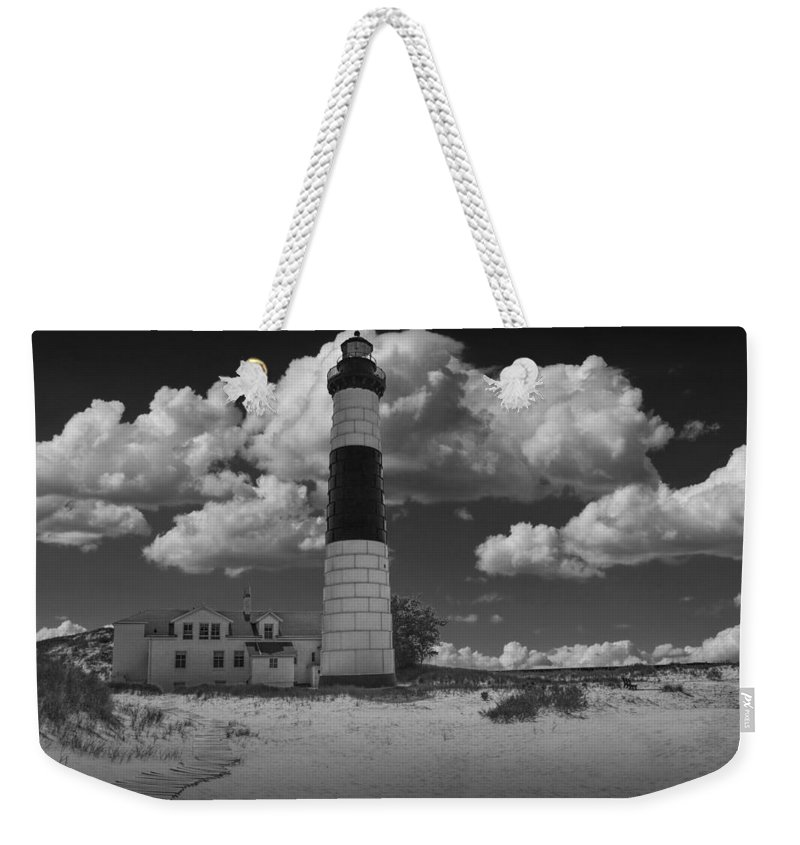 Michigan Weekender Tote Bag featuring the photograph Big Sable Lighthouse Under Cloudy Skies by Randall Nyhof