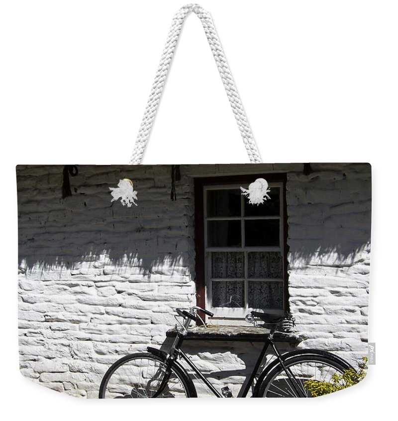 Irish Weekender Tote Bag featuring the photograph Bike At The Window County Clare Ireland by Teresa Mucha