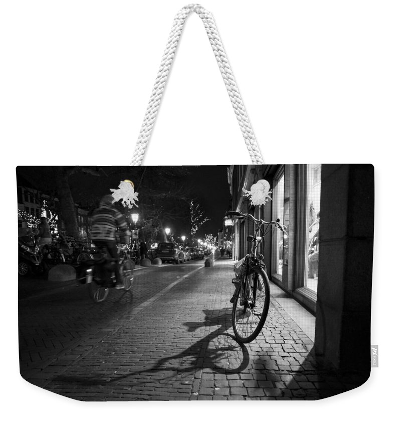 Man Riding On Bike Weekender Tote Bag featuring the photograph Bike Between Lights And Shadows, Netherlands by David Ortega Baglietto