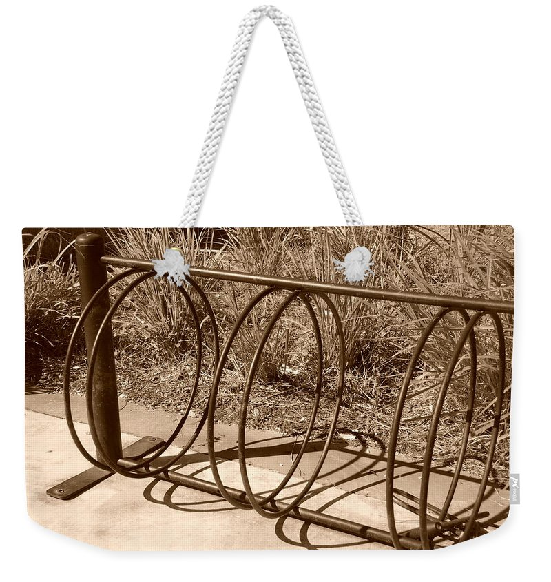 Bicycle Weekender Tote Bag featuring the photograph Bike Rack by Rob Hans