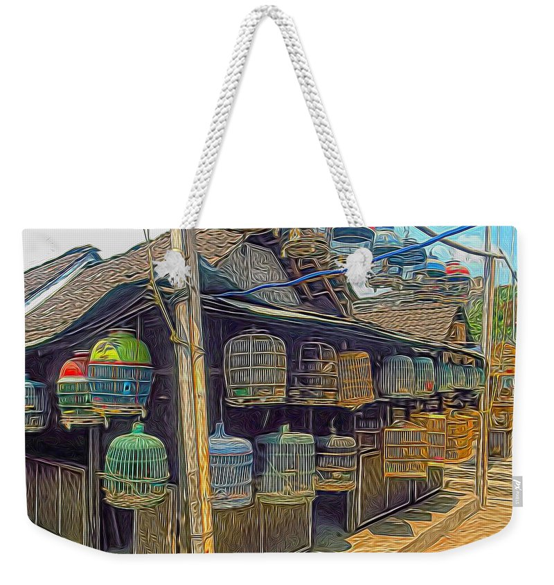 Weekender Tote Bag featuring the digital art Bird Cages Vintage Photo Indonesia by Cathy Anderson