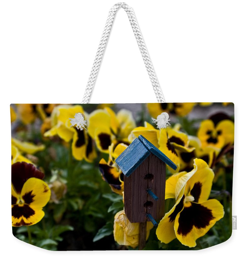 Pansy Weekender Tote Bag featuring the photograph Bird house and Pansey by Douglas Barnett