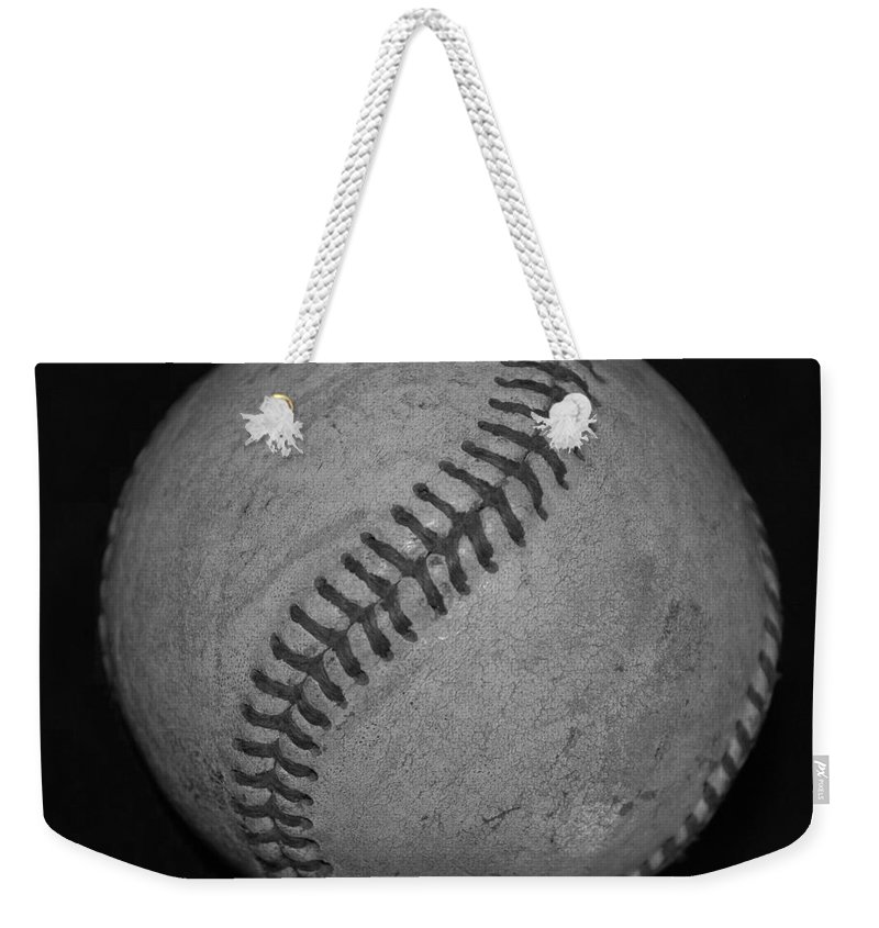 Baseball Weekender Tote Bag featuring the photograph Black And White Baseball by Rob Hans