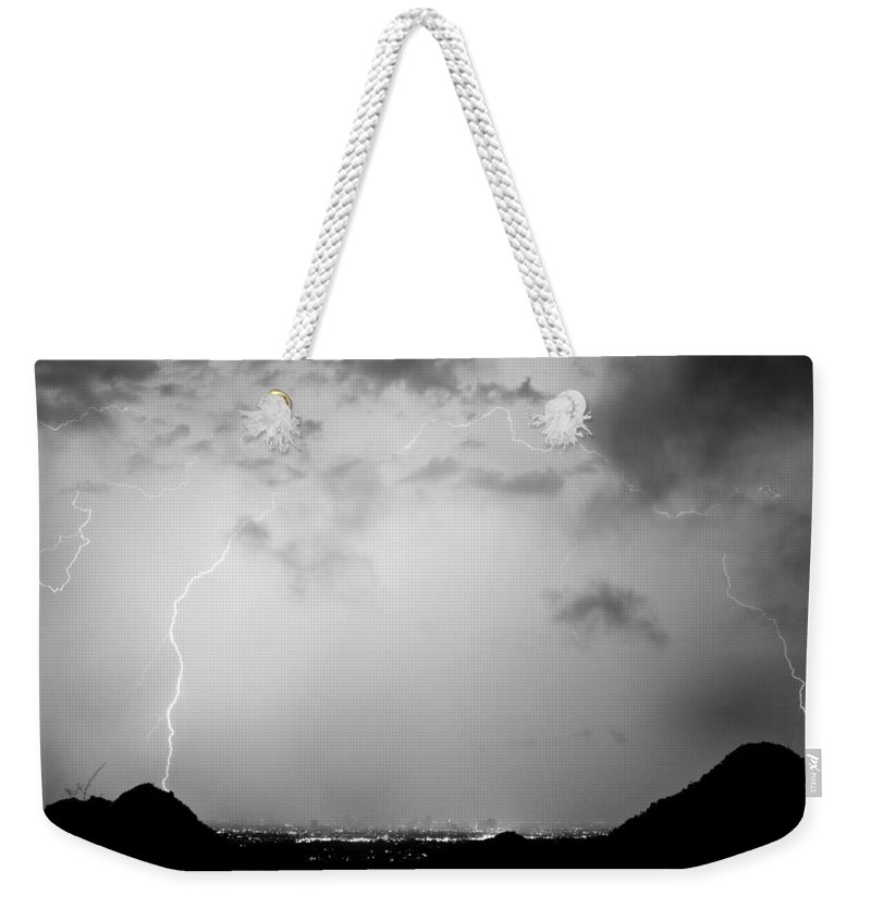 Lightning Weekender Tote Bag featuring the photograph Black And White Lightning Dome Over City Lights by James BO Insogna