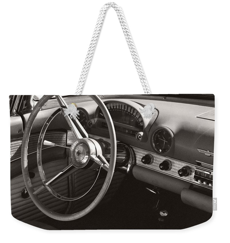 Black Weekender Tote Bag featuring the photograph Black And White Thunderbird Steering Wheel And Dash by Heather Kirk