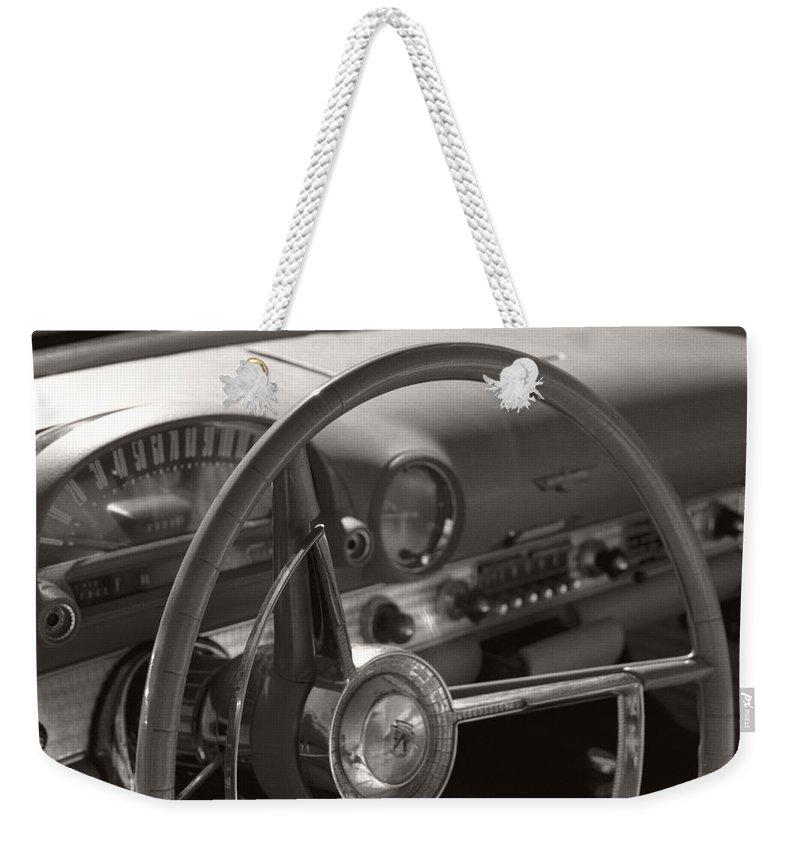 Black And White Photography Weekender Tote Bag featuring the photograph Black And White Thunderbird Steering Wheel by Heather Kirk
