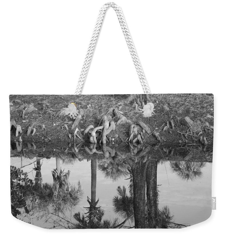 Roots Weekender Tote Bag featuring the photograph Black And White Water Reflections by Rob Hans