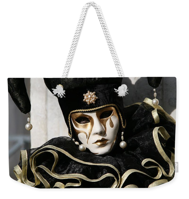 Black Weekender Tote Bag featuring the photograph Black Jester by Donna Corless
