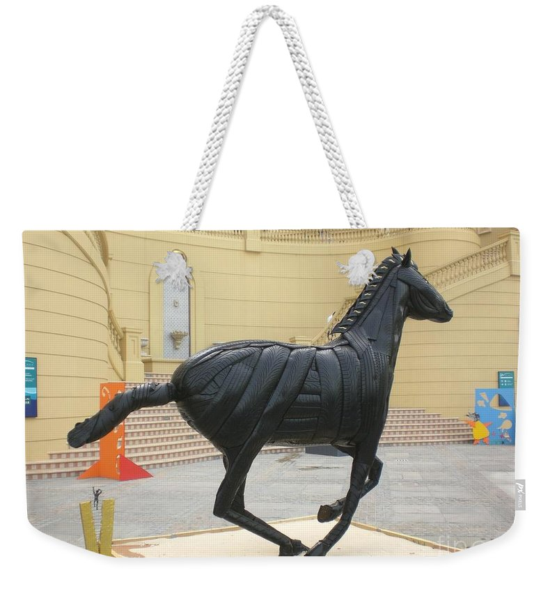 Horse Weekender Tote Bag featuring the sculpture Black Stalion Tyre Sculpture by Mo Siakkou-Flodin