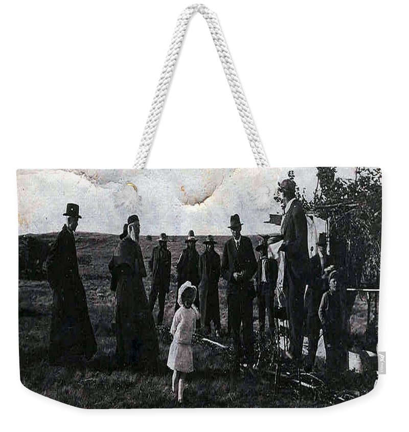 Old Fashioned Black And White Church Children Settlers Pioneers Ceremony Weekender Tote Bag featuring the photograph Blessings And Dreams by Andrea Lawrence