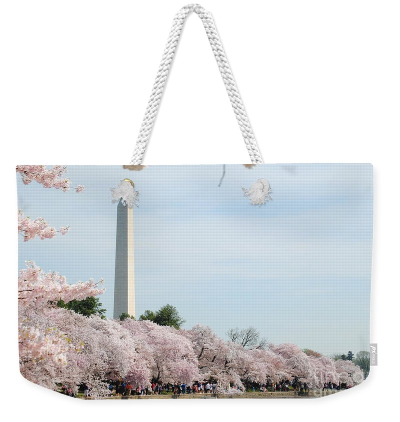 Cherry Weekender Tote Bag featuring the photograph Blooms Of The Tidal Basin by Jost Houk