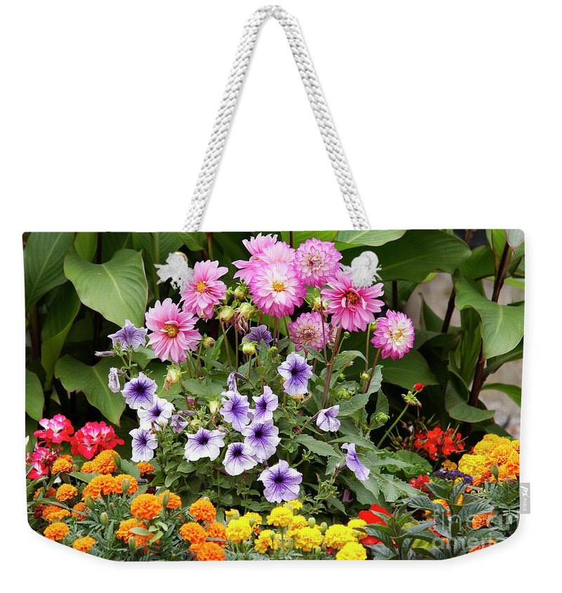 Bouquet Weekender Tote Bag featuring the photograph Blossoming Flowers by Michal Boubin
