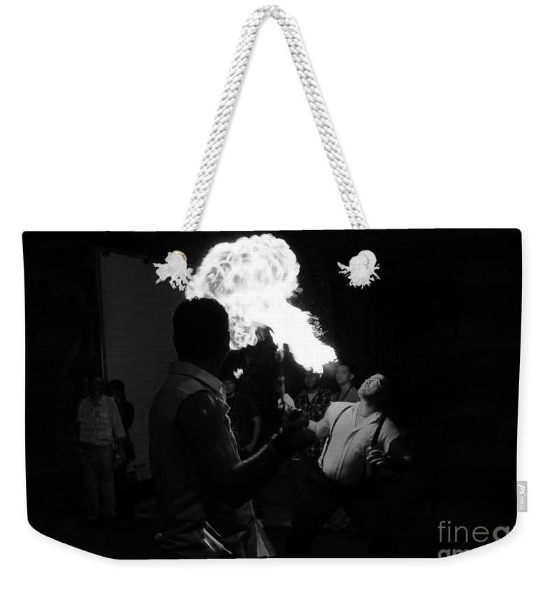 Fire Weekender Tote Bag featuring the photograph Blowing Fire by David Lee Thompson