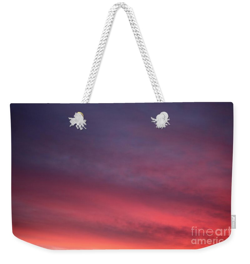 Sunset Weekender Tote Bag featuring the photograph Blue And Orange Sunset by Nadine Rippelmeyer