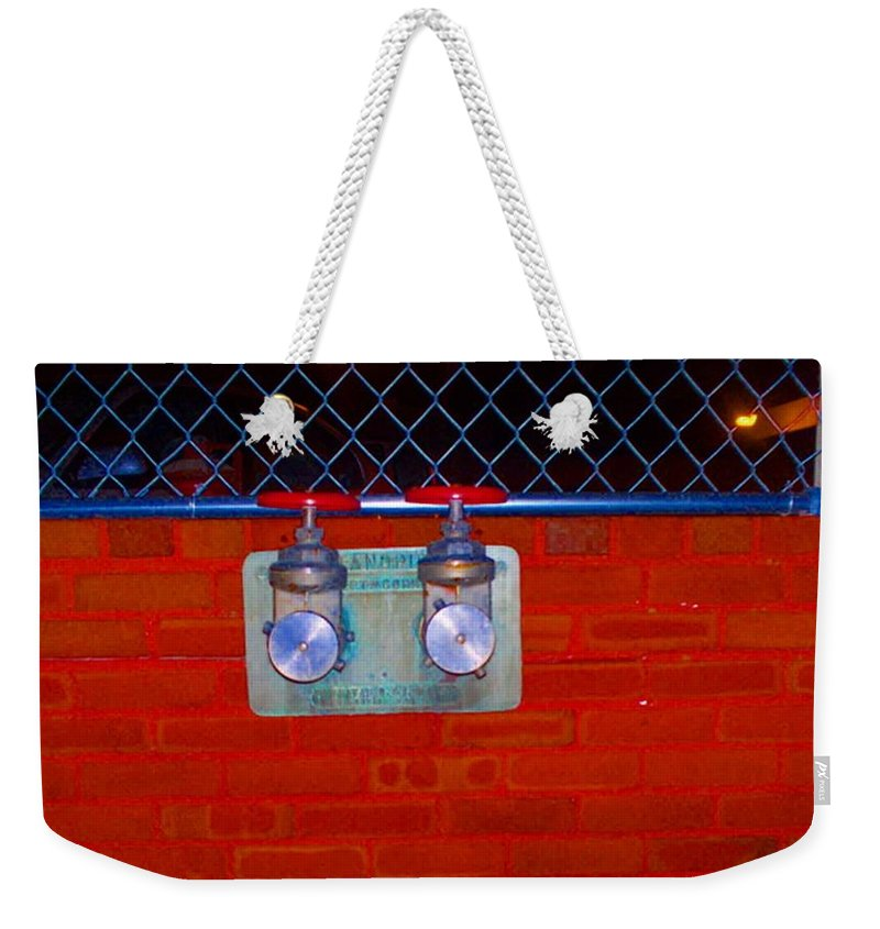Color Photograph Weekender Tote Bag featuring the photograph Blue And Red Pipe by Thomas Valentine