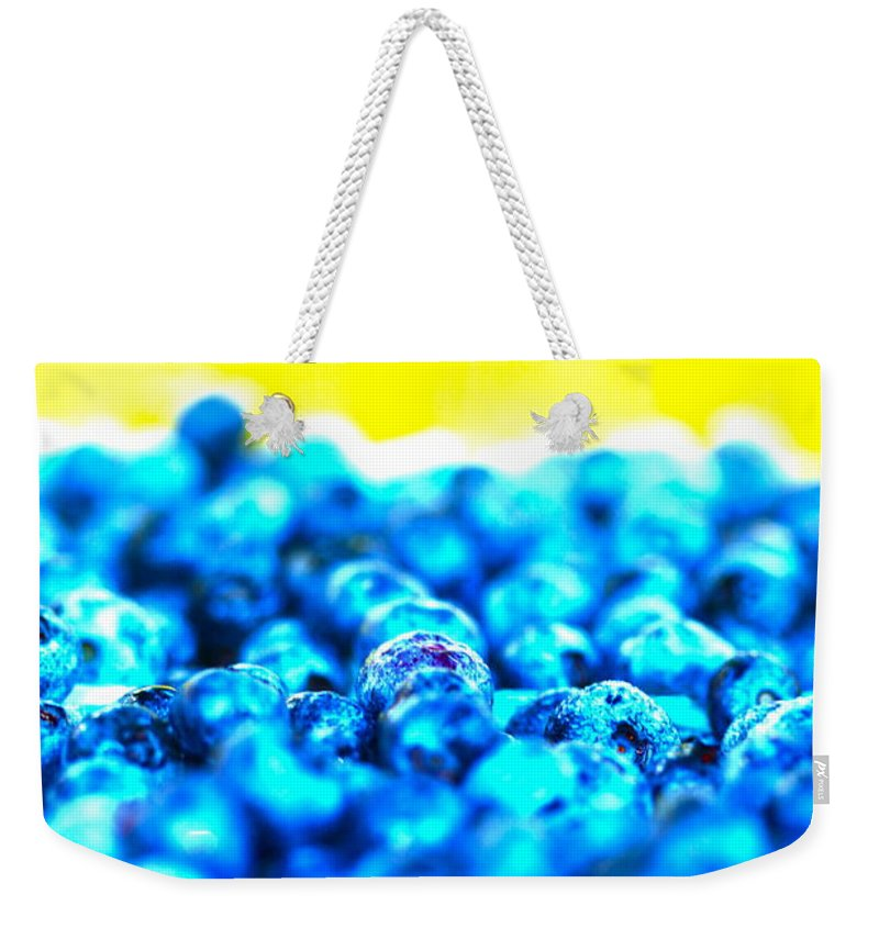 Blue Weekender Tote Bag featuring the photograph Blue Blur by Nadine Rippelmeyer