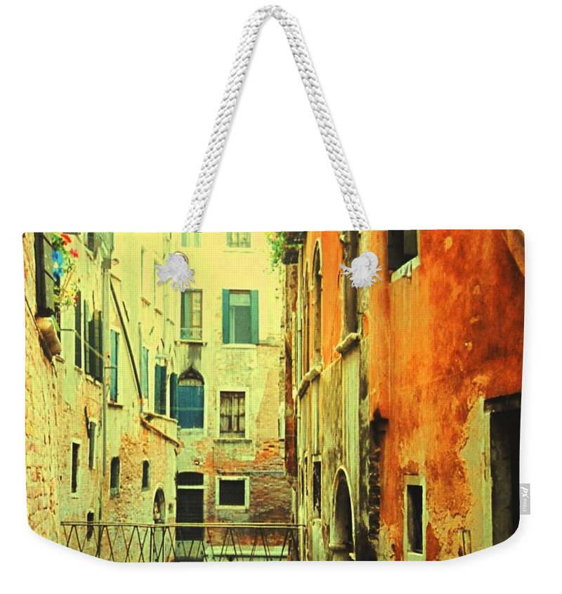 Venice Weekender Tote Bag featuring the photograph Blue Boat In Venice by Ian MacDonald