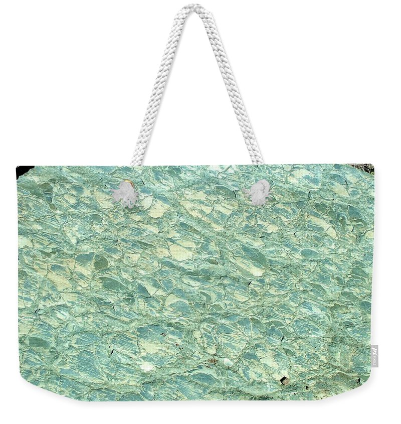 Pale Blue Stone Weekender Tote Bag featuring the photograph Blue Fossil by Tracey Vivar