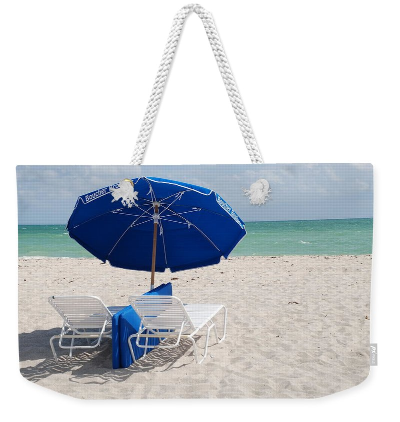 Sea Scape Weekender Tote Bag featuring the photograph Blue Paradise Umbrella by Rob Hans