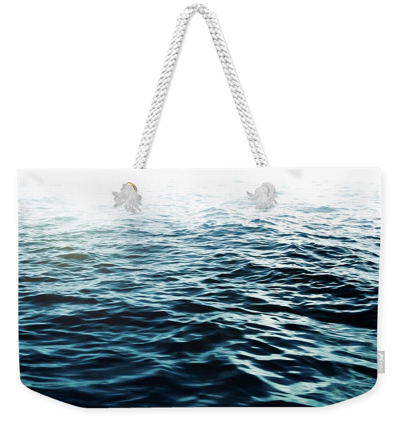 Sea Weekender Tote Bag featuring the photograph Blue Sea by Nicklas Gustafsson