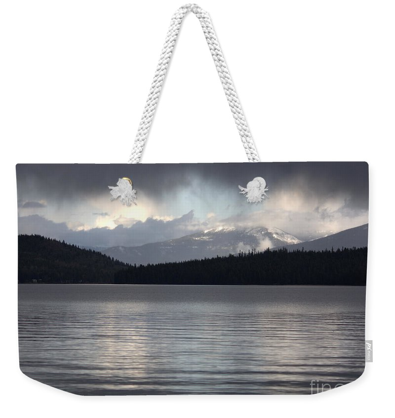 Clouds Weekender Tote Bag featuring the photograph Blue Sky Through Dark Clouds by Carol Groenen