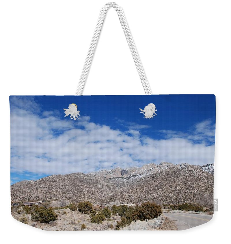 Sandia Mountains Weekender Tote Bag featuring the photograph Blue Skys Over The Sandias by Rob Hans