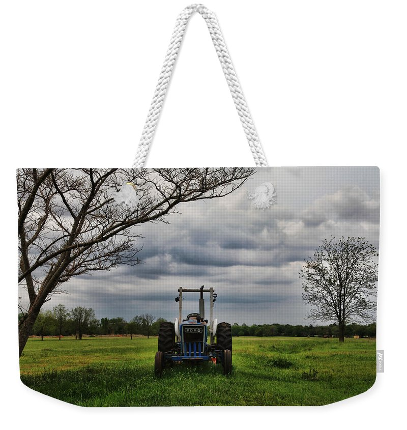 Tractor Weekender Tote Bag featuring the photograph Blue Tractor Green Field by Toni Hopper