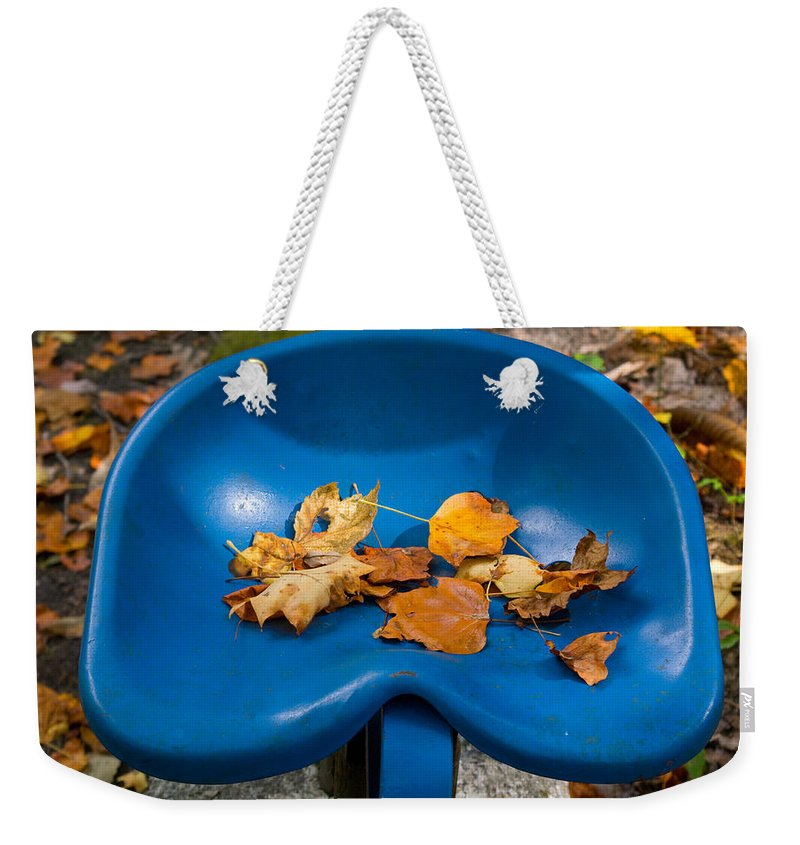 Cumberland Weekender Tote Bag featuring the photograph Blue Tractor Seat by Douglas Barnett