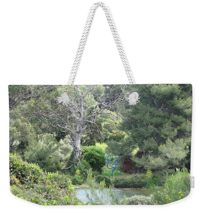 Weekender Tote Bag featuring the photograph Blue Tree by Andres Chauffour