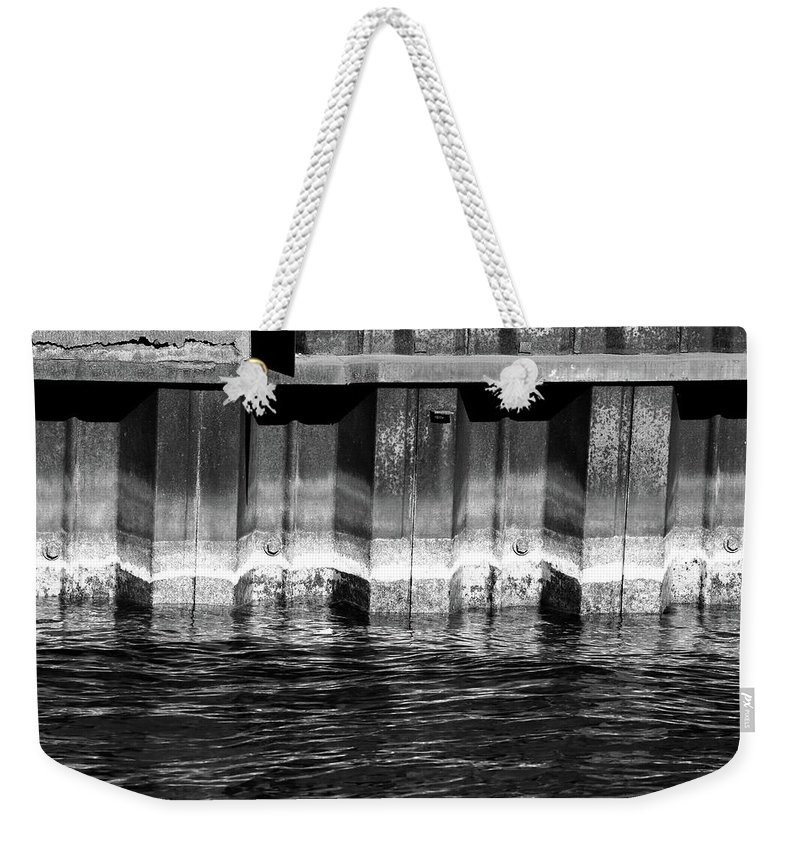 Water Weekender Tote Bag featuring the photograph Blue Water Retaining Wall 4 Bw by Mary Bedy