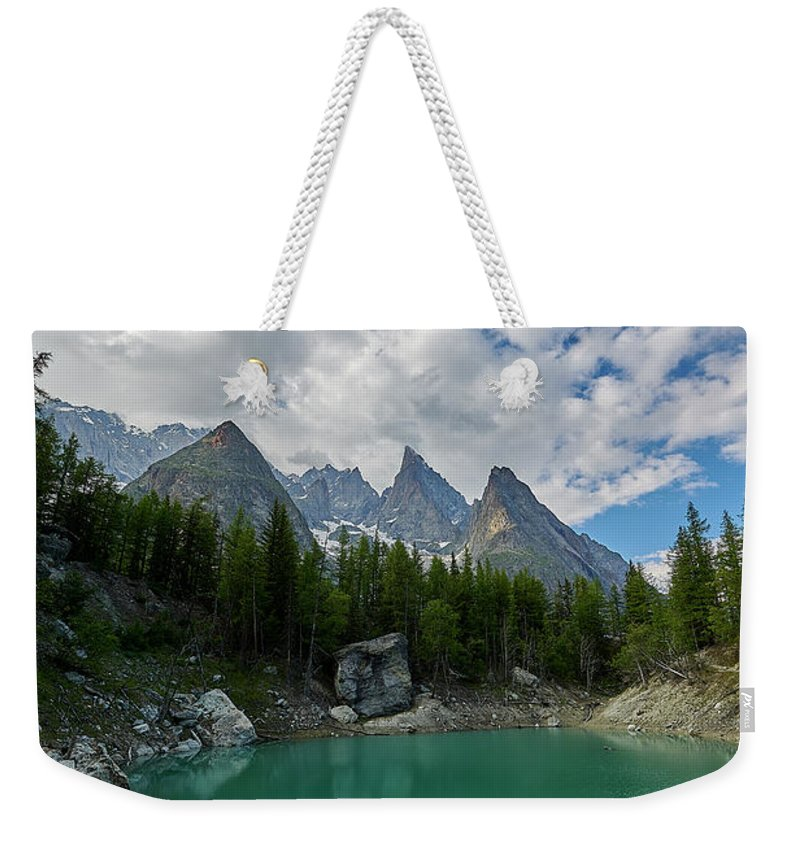 Courmayeur Weekender Tote Bag featuring the photograph Blue Waters Of The French Alps by Jon Glaser
