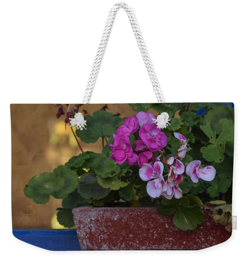 Window Weekender Tote Bag featuring the photograph Blue Window With Geraniums by TouTouke A Y