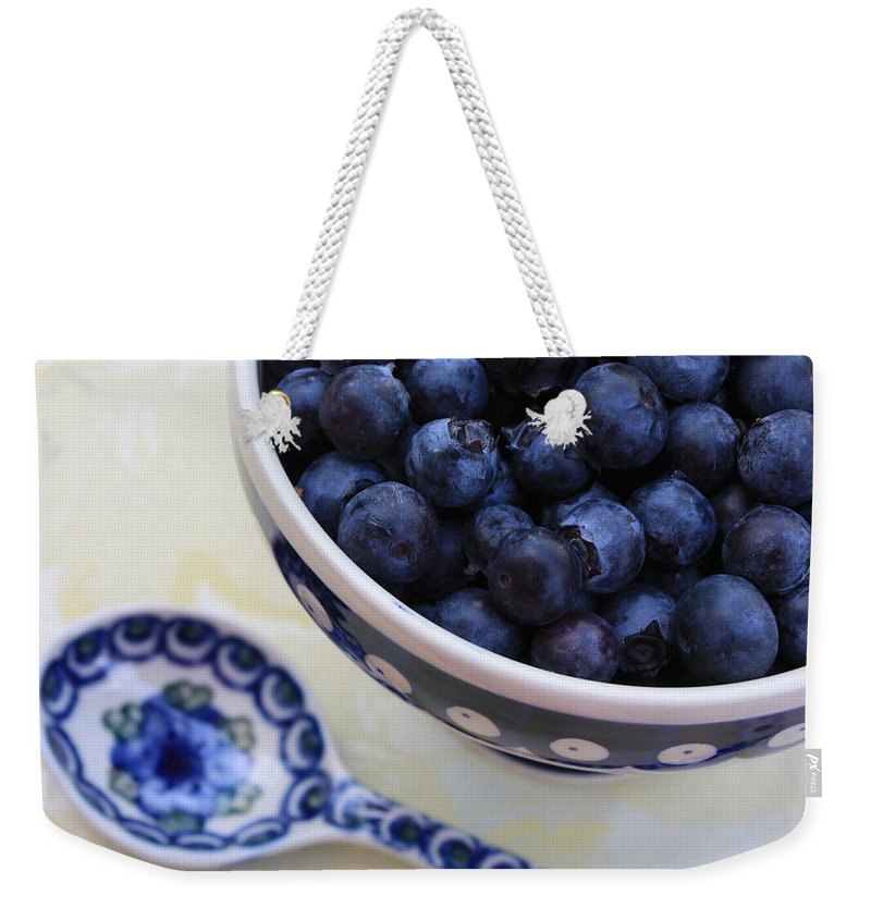 Still Life Of Fruit Weekender Tote Bag featuring the photograph Blueberries And Spoon by Carol Groenen