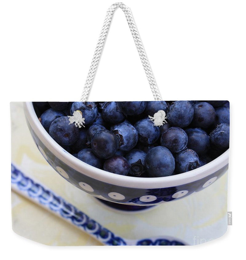 Food Weekender Tote Bag featuring the photograph Blueberries In Polish Pottery Bowl by Carol Groenen