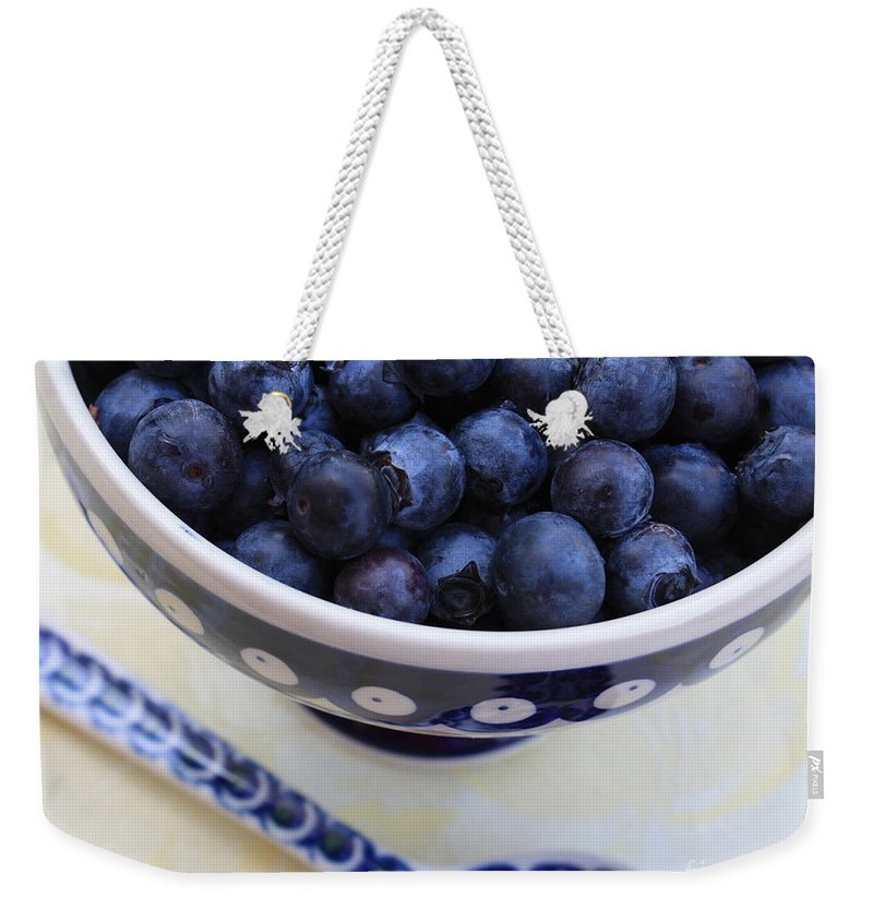 Food Weekender Tote Bag featuring the photograph Blueberries With Spoon by Carol Groenen