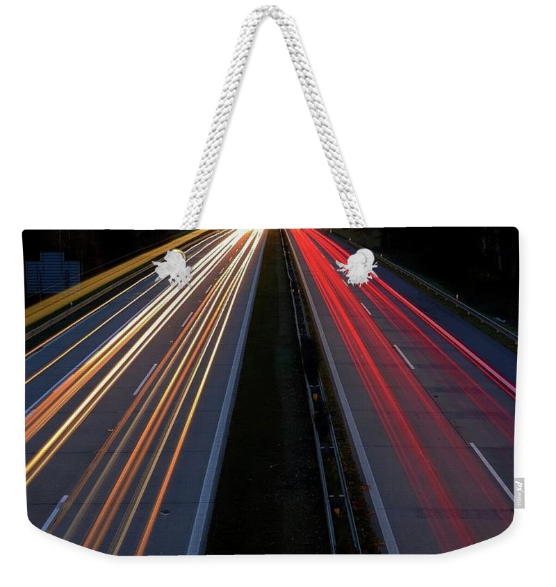 Intensity Weekender Tote Bag featuring the photograph Blurred Lights Lines On Highway by Hamik ArtS