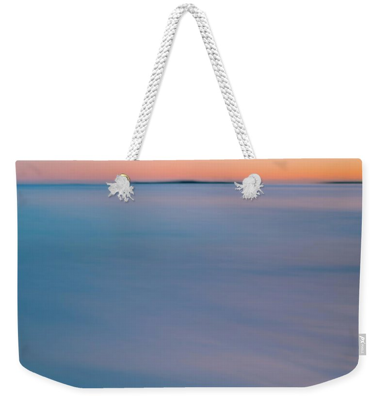 Vacation Weekender Tote Bag featuring the photograph Blurry Ocean Sunrise by Anthony Doudt