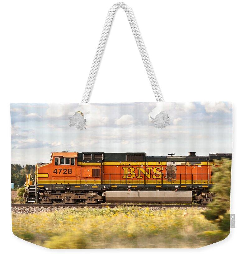 Bnsf Railway Weekender Tote Bag featuring the photograph Bnsf Railway Engine by Robert J Caputo