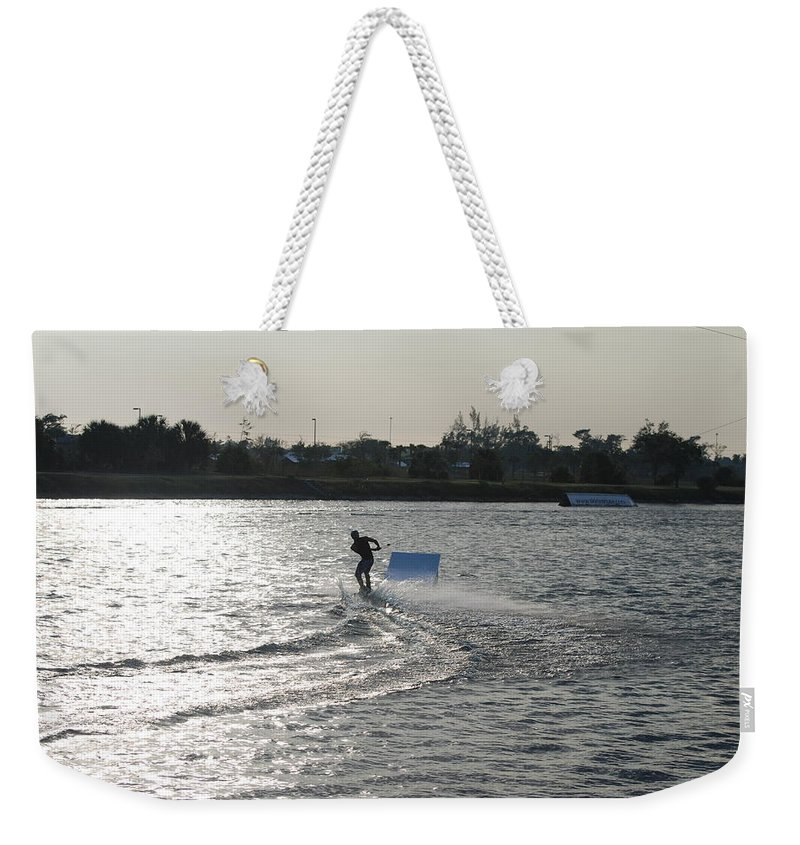 Waves Weekender Tote Bag featuring the photograph Board Jump by Rob Hans