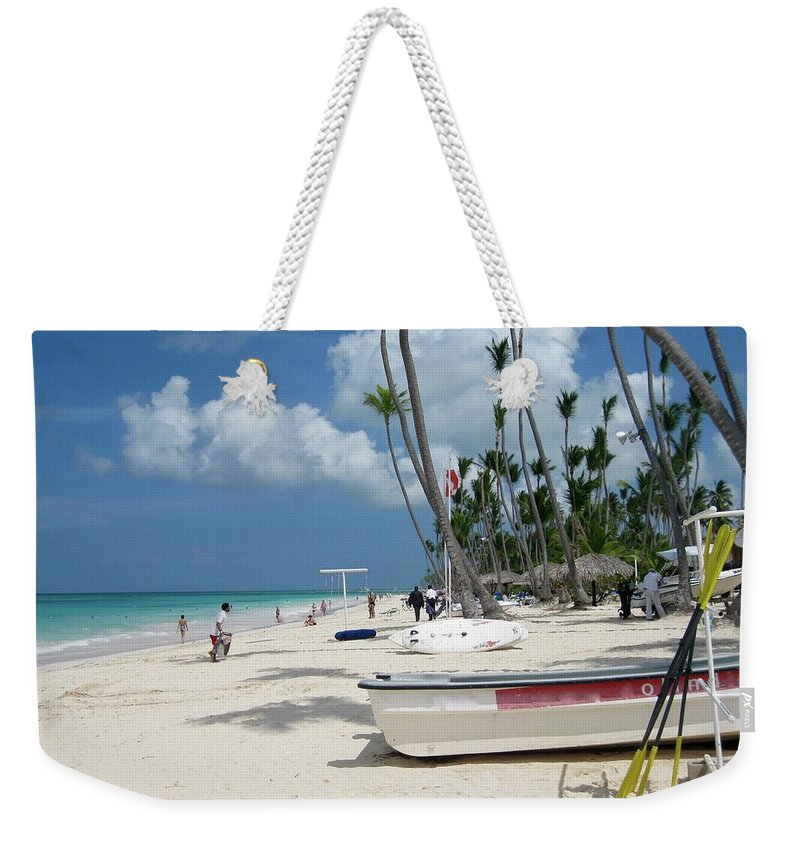 Boat Weekender Tote Bag featuring the photograph Boat On The Beach by Cynthia Iwen