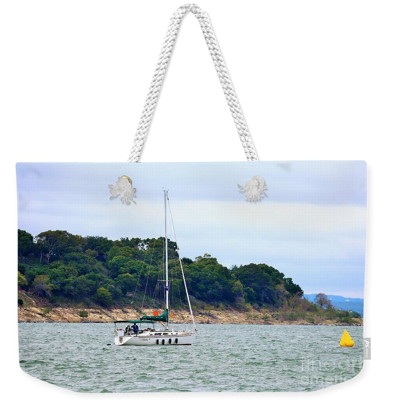 Landscape Weekender Tote Bag featuring the photograph Boat On A Lake by Jeff Downs