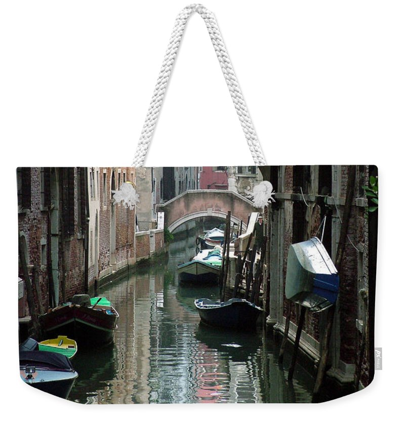 Venice Weekender Tote Bag featuring the photograph Boat On The Wall by Donna Corless