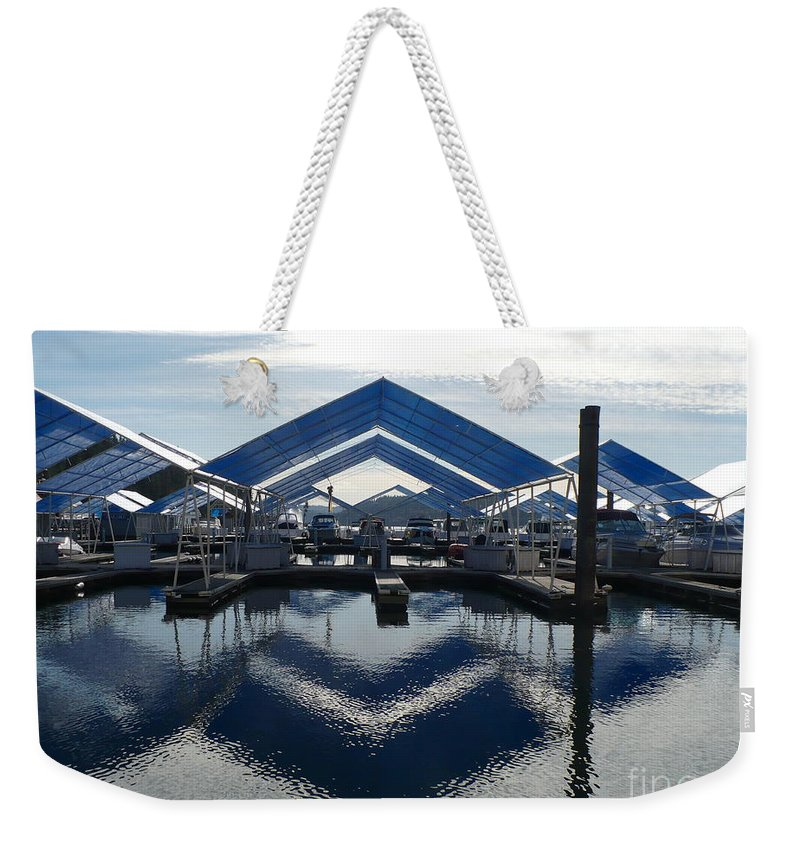 Boats Weekender Tote Bag featuring the photograph Boat Reflection On Lake Coeur D'alene by Carol Groenen