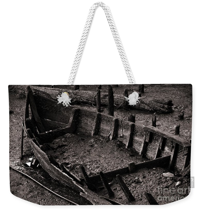 Abandon Weekender Tote Bag featuring the photograph Boat Remains by Carlos Caetano