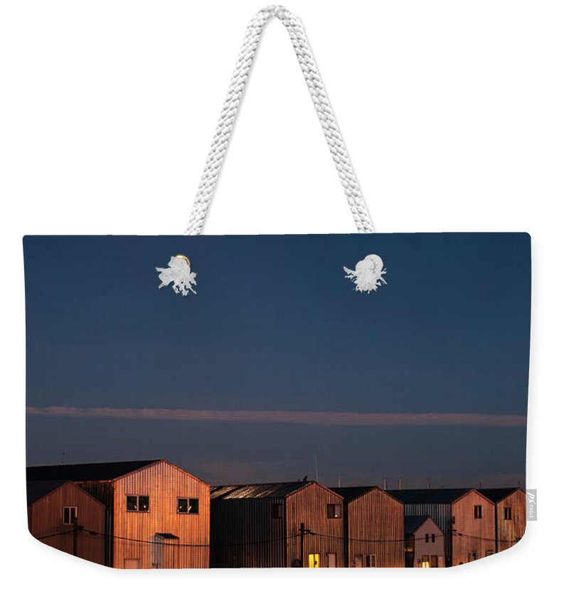 Everett Marina Weekender Tote Bag featuring the photograph Boathouse Reflections With Moonset by Jim Corwin