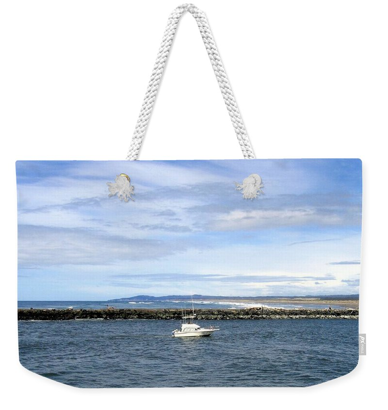 Boat Weekender Tote Bag featuring the photograph Boating At Bandon by Will Borden