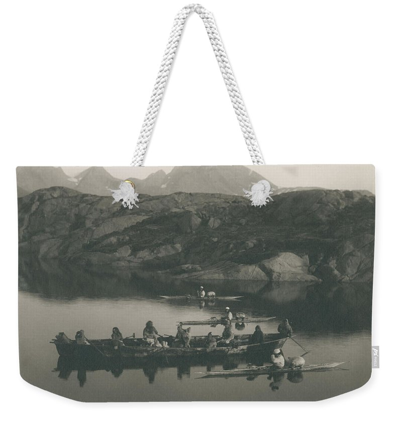 Women�s Boats And Kayaks Near Ammassalik. Greenland Weekender Tote Bag featuring the painting Boats And Kayaks Near by Krabbe